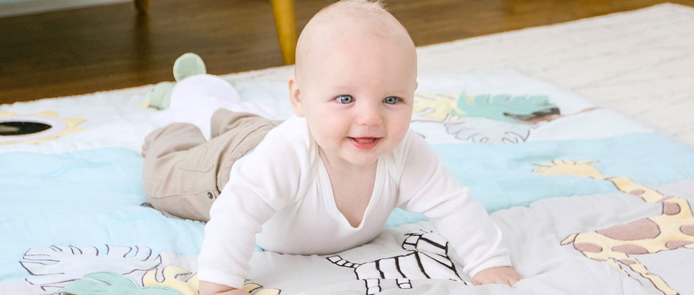 Baby playing on the cotton muslin baby bonding playmat